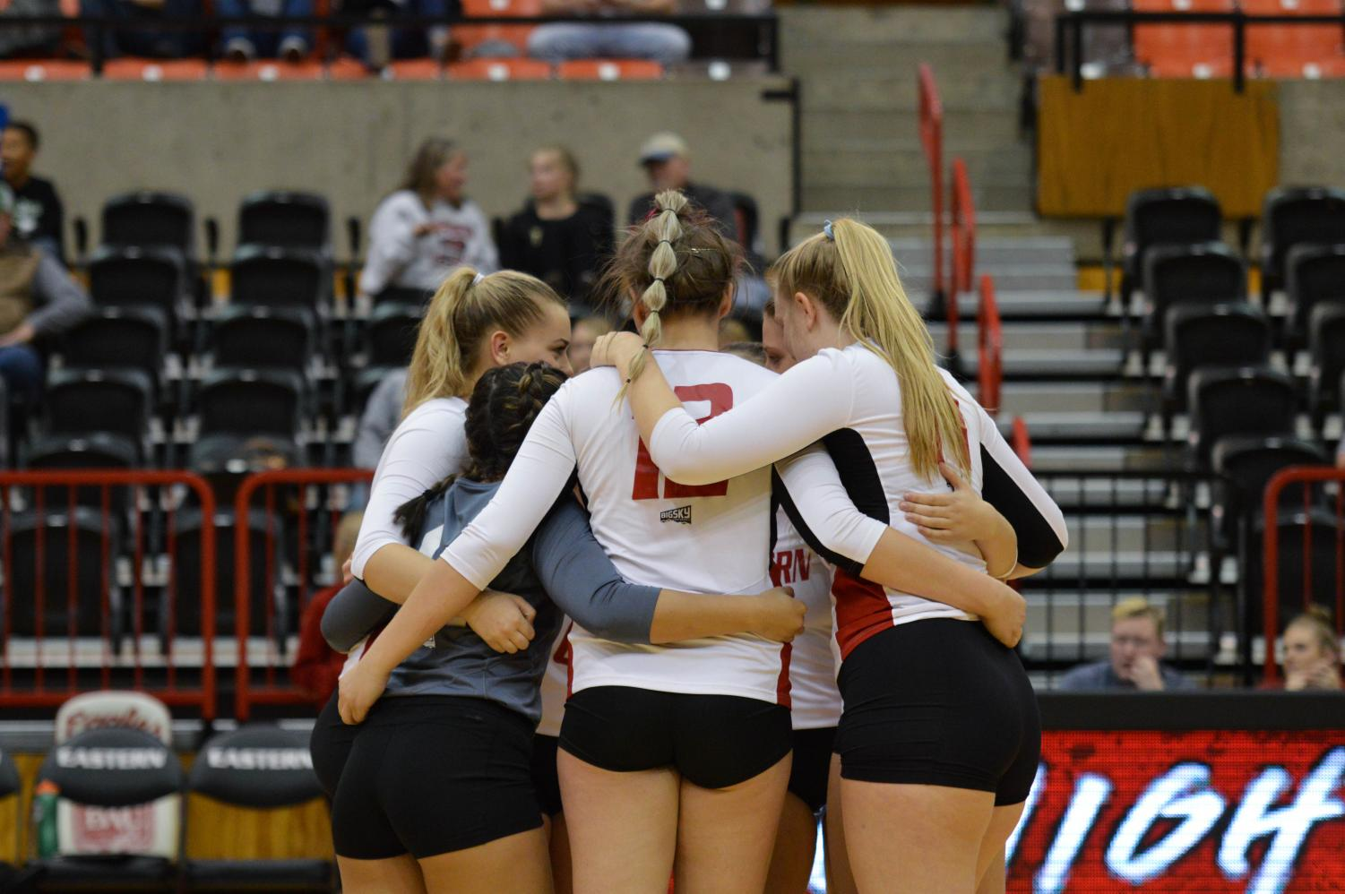 The Eagles huddle up after a point. EWU lost three straight sets after winning the first to lose to Northern Colorado on Oct. 20.