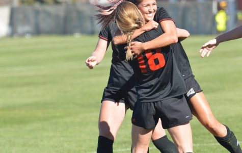 Senior Alexis Stephenson (18) embraces senior Devan Talley during EWU's 8-1 senior day win over Idaho State. With the victory on Sunday, the Eagles improved to sixth in the six-team playoff race with two weekends remaining before the conference tournament. | Bailey Monteith for The Easterner