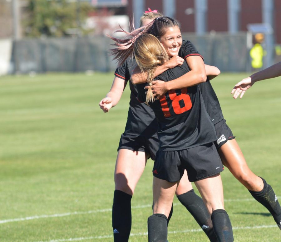 Senior Alexis Stephenson (18) embraces senior Devan Talley during EWUs 8-1 senior day win over Idaho State. With the victory on Sunday, the Eagles improved to sixth in the six-team playoff race with two weekends remaining before the conference tournament. | Bailey Monteith for The Easterner
