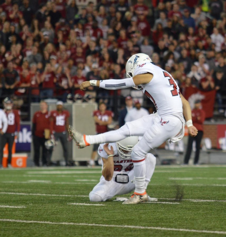 Senior Roldan Alcobendas attempts a field goal against Washington State on Sept. 15. Alcobendas is one of six kickers in the nation to make every field goal attempt this year.