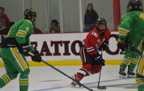 Freshman Mitch Hunt weaves through Oregon defenders on Oct. 5. Hunt leads the hockey team with 23 points.
