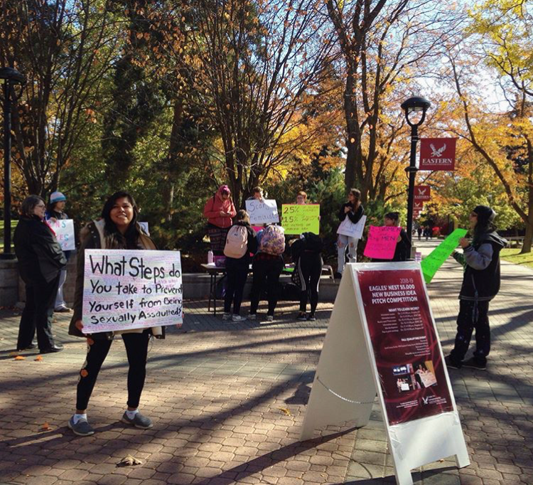 The Scary Feminists club engage with students during Believe Survivors Rally in campus mall.