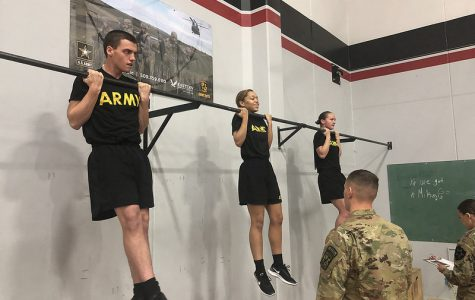 (Left to right) EWU ROTC Cadets Thomas Luce, Amayia Roberts and Megan Anderson compete in the flexed arm hang event. Competitors were required to complete a variety of tests in order to receive the German Armed Forces Proficiency Badge.