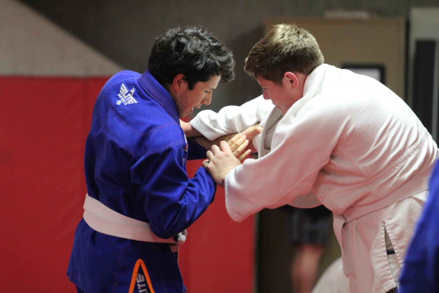 Members of the Brazilian ju-jitsu club grapple in practice on Oct. 22. The club meets bi-weekly in Reece Pavilion 309B.