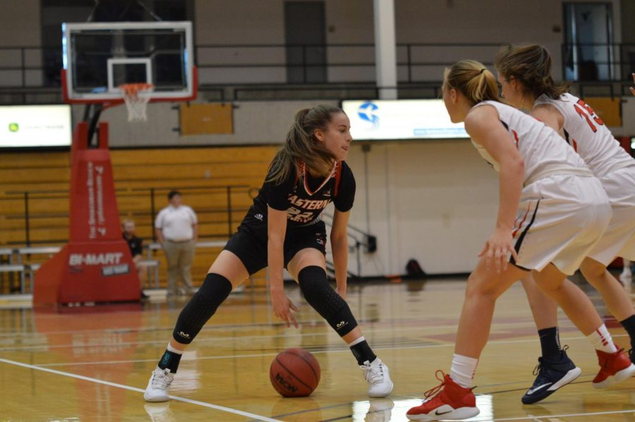 Sophomore+Brittany+Klaman+crosses+over+on+SFU+defenders.+Klaman+finished+the+game+with+seven+assists+and+six+rebounds.+