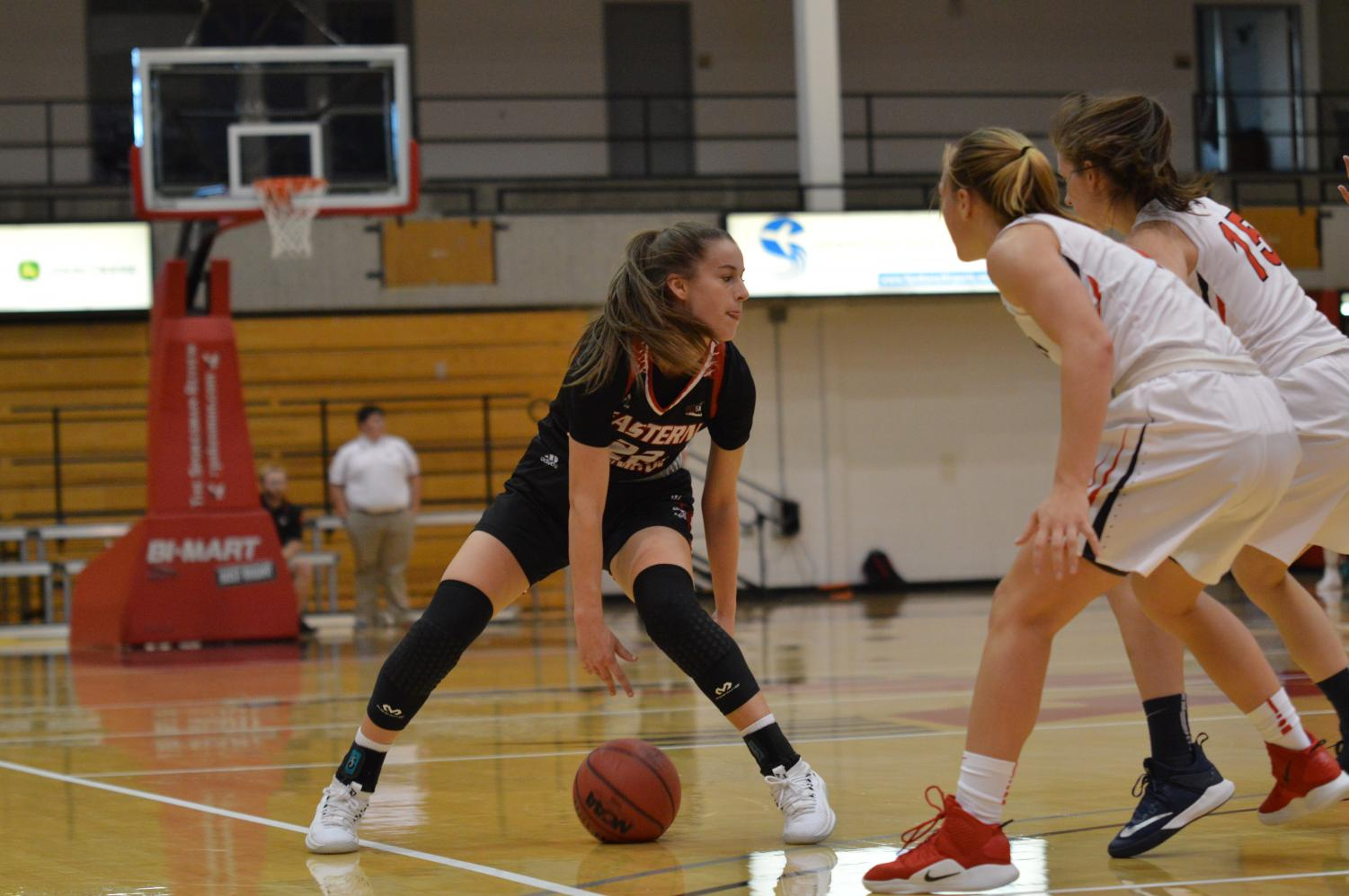 Sophomore Brittany Klaman crosses over on SFU defenders. Klaman finished the game with seven assists and six rebounds.