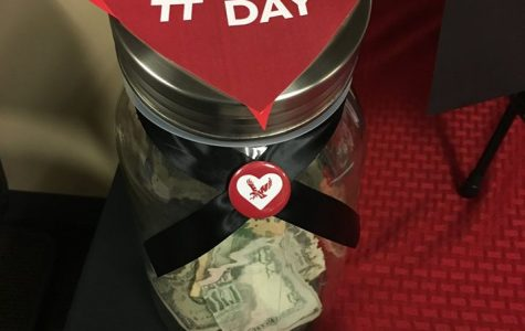 Donation jar set up for Giving Joy Day. Much of the money raised on Nov. 27 will go toward student scholarships.