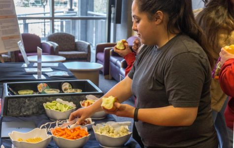 EWU junior Maria Rivera enjoys free fruit and vegetables at the Real Food Fair in JFK Library. The fair had free food and hot apple cider for students to enjoy while learning about sustainability.