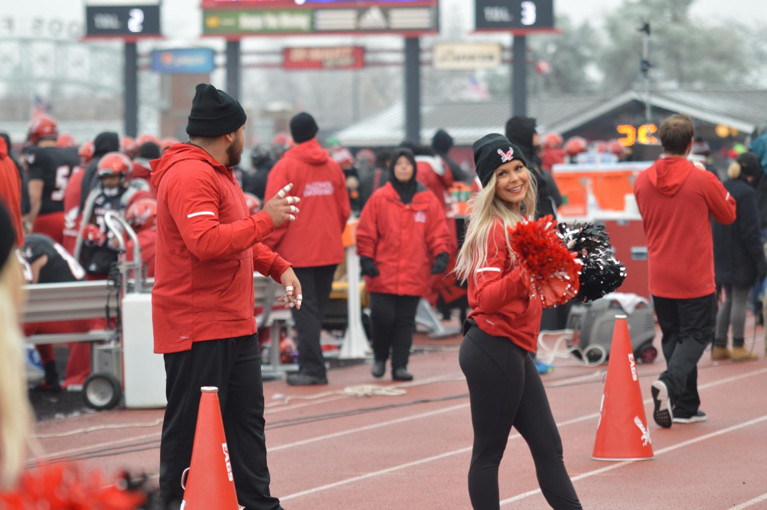 David Valdovinos and Brittany Brattin of the cheer club face the crowd at the football game against UC Davis on Nov. 10. Brattin has been a member of the club for three years.