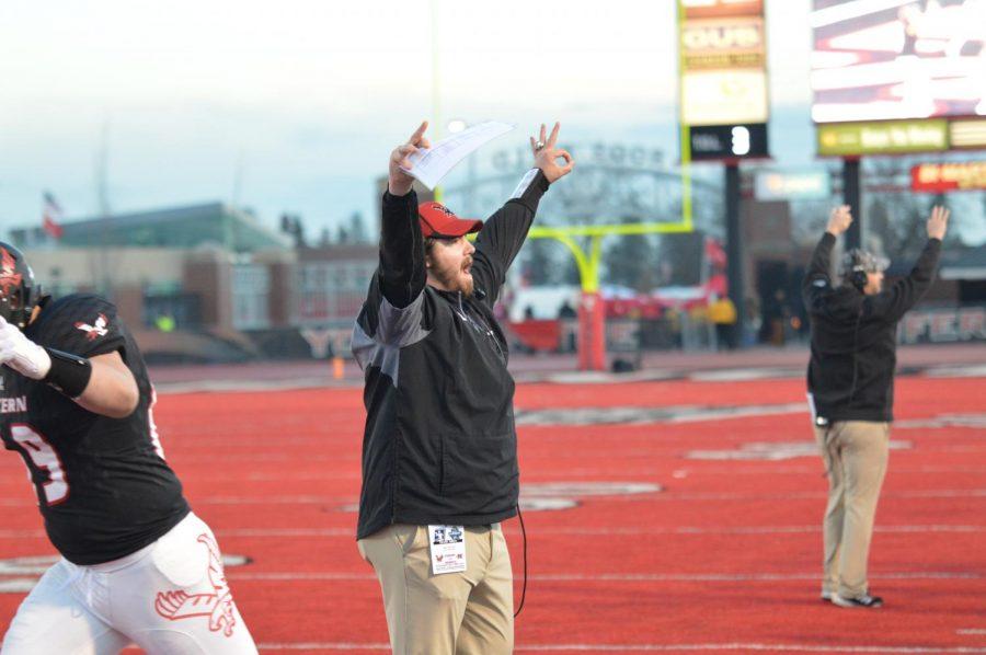Offensive line coach Jase Butorac celebrates a touchdown. EWU ran for 237 yards in the game.