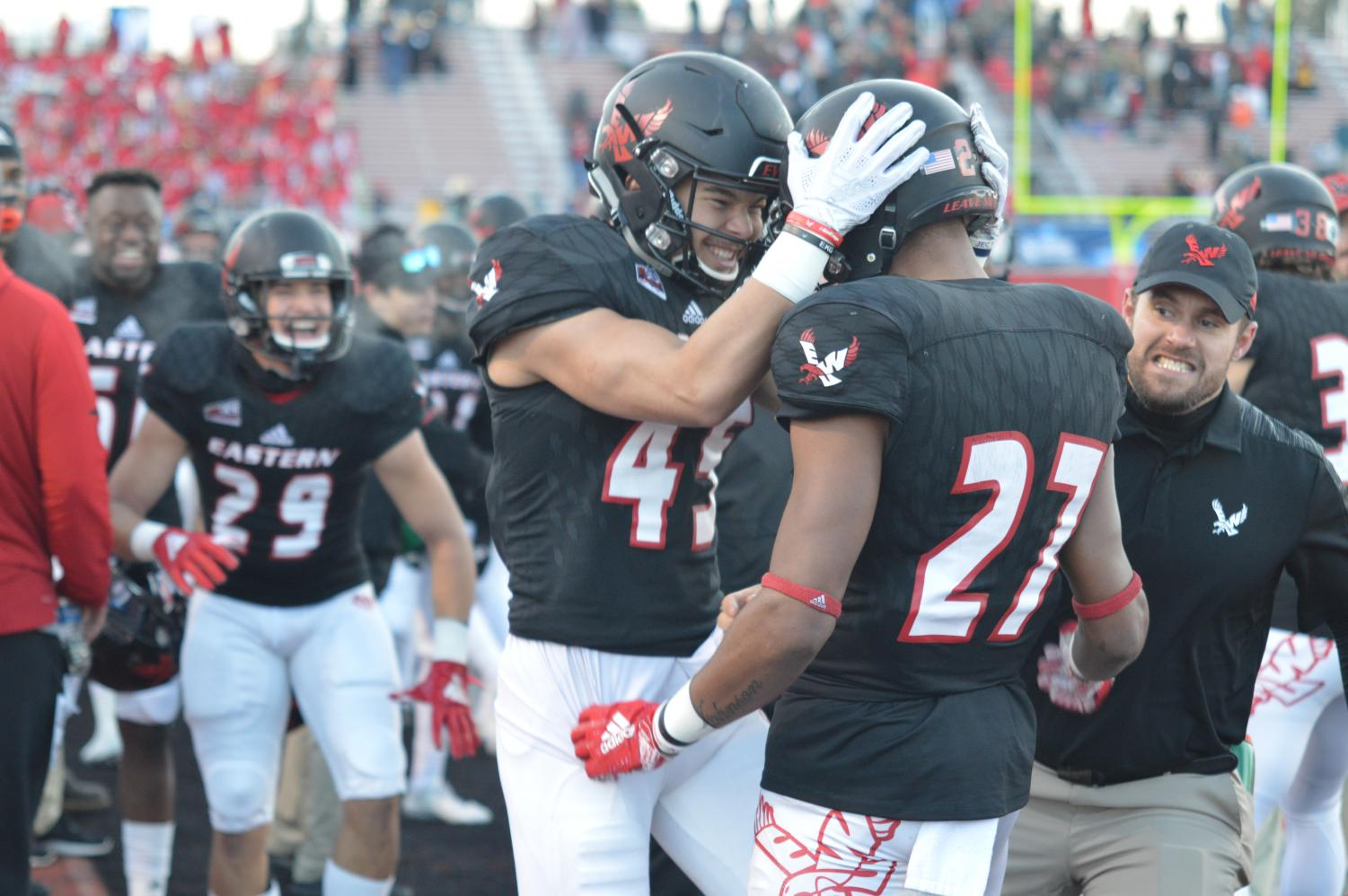 Sophomore Tamir Hill celebrates with Sophomore Kedrick Johnson after Johnson returned a blocked field goal for a touchdown at the end of the first half. The Eagles scored 13 points on special teams and seven on defense.