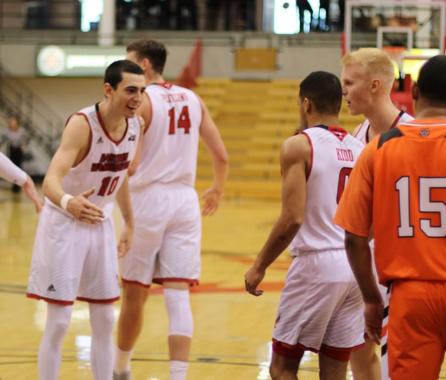 Sophomore guard Jacob Davison celebrates junior guard Tyler Kidd earning a trip to the free throw line. Davison scored 15 points in the 65-55 win over Idaho State on Monday.