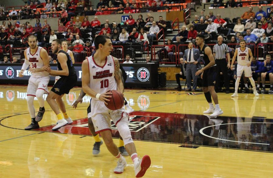 Sophomore guard Jacob Davison sizes up a SDSU defender on Tuesday. Davison finished the game with a team high 20 points.