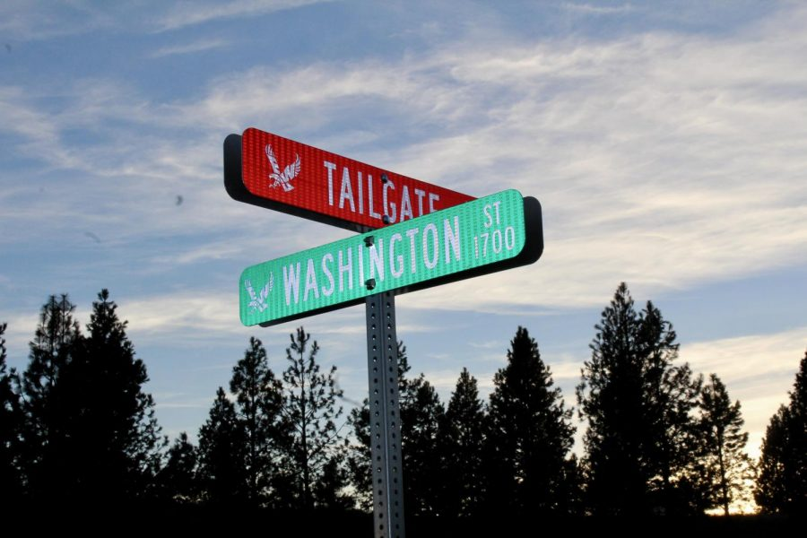 Tailgate road leads to the upper parking lot behind Roos Field. Red signs have been placed around the EWU campus to help guide new students and visitors.
