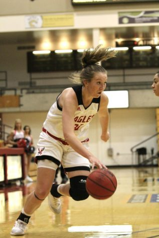 Freshman guard Grace Kirscher drives the ball against Norther Colorado on Monday. Kirscher scored 14 points and a team high four made 3-pointers in 2019.
