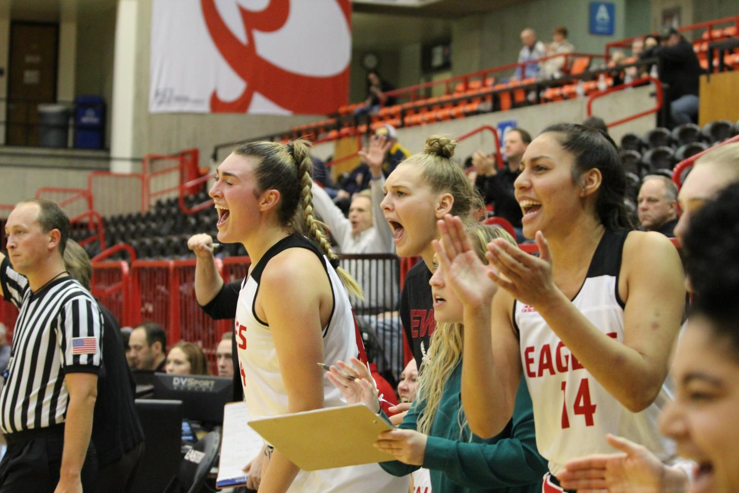 Bella Cravens and Leya DePriest cheer on the team late in the game against Northern Colorado on Monday. The Bears are yet to lose in Big Sky play this year.