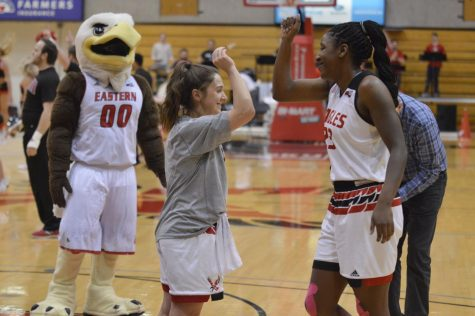 Cunningham high-fives teammate Baylee Rexing on Feb. 22, 2018. In her EWU basketball career Cunningham averaged 2.6 points and 2.1 rebounds in 113 games. Image from 2019.
