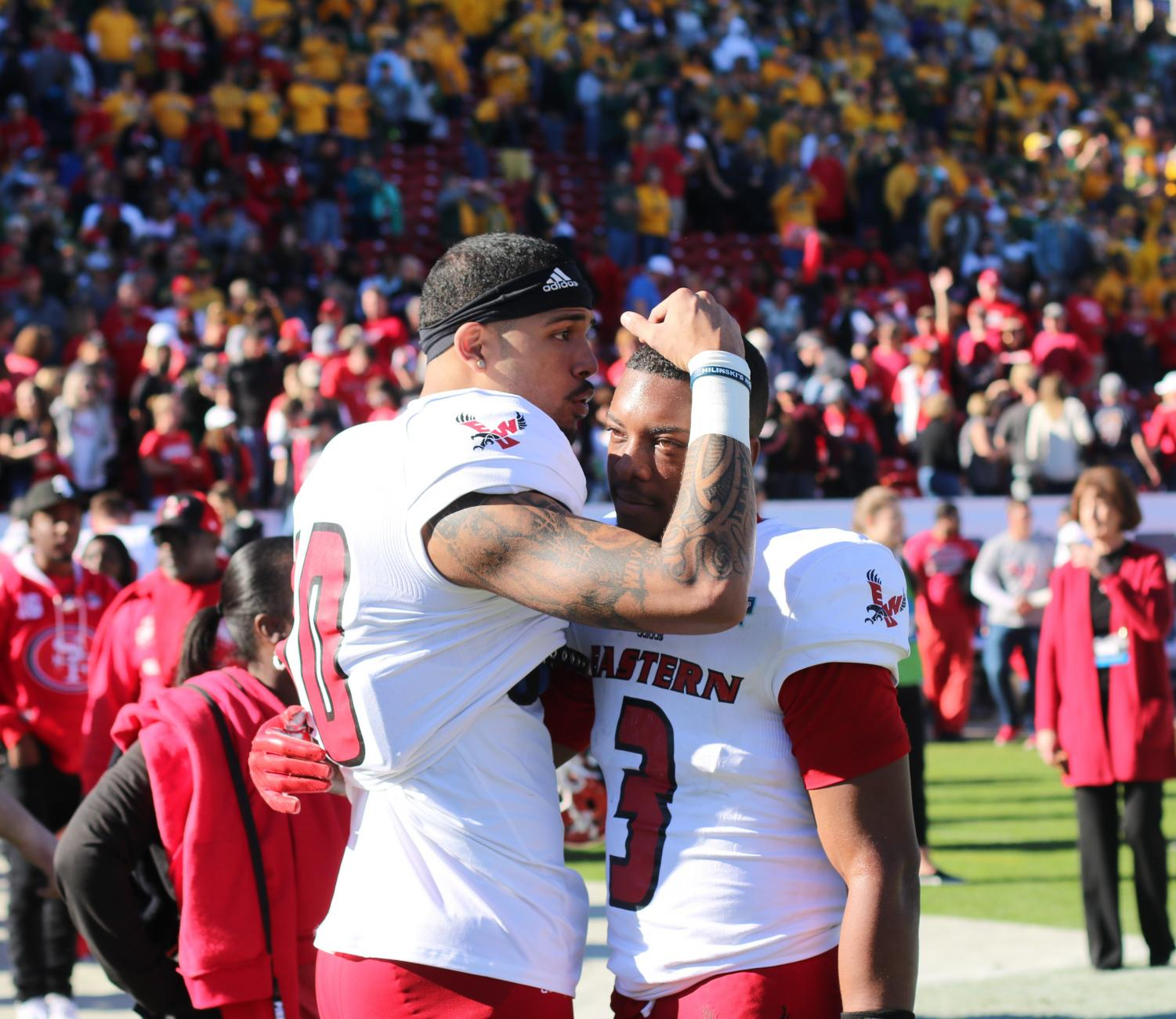 Freshman Talolo Limu-Jones consoles Sophomore Eric Barriere after the Eagles 38-24 loss to NDSU in the FCS National Championship on Saturday. Barriere threw for 198 yards and rushed a touchdown in the game.
