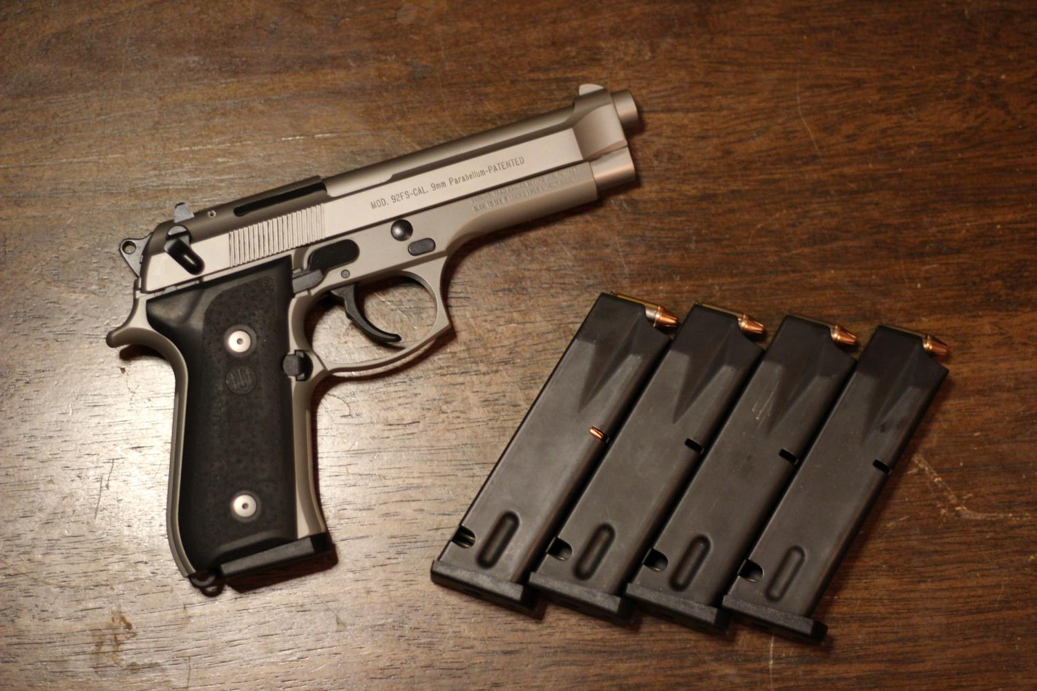 A Beretta 92FS handgun with four, 15 round magazines. The Alliance for Gun Responsibility would consider these magazines to be high-capacity, since they hold over 10 rounds.