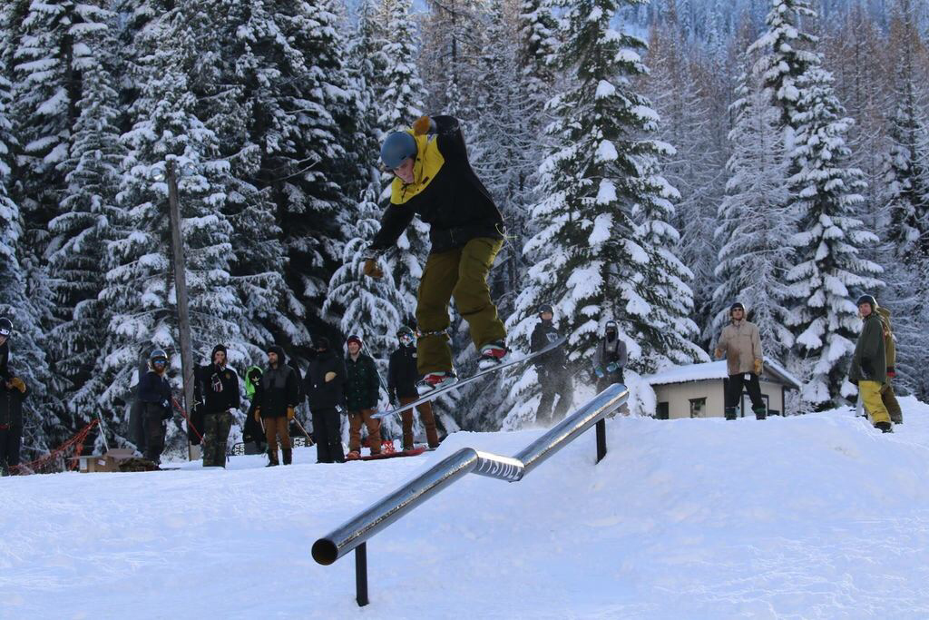 Sophomore Davis Croson attempts to grind a rail at 49 North's ThanksJibbing event on Nov. 24. Croson has also competed at Mt. Spokane, mostly doing charity events.