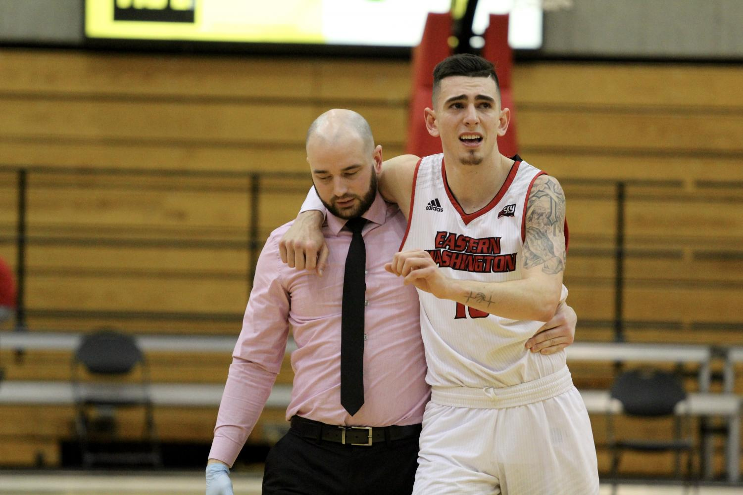 Sophomore guard Jacob Davison is helped off the court after suffering a sprained ankle with just under 10 minutes remaining in the second half. The Eagles didn't score for the last three and a half minutes of regulation, but dominated the overtime period to win 88-78.