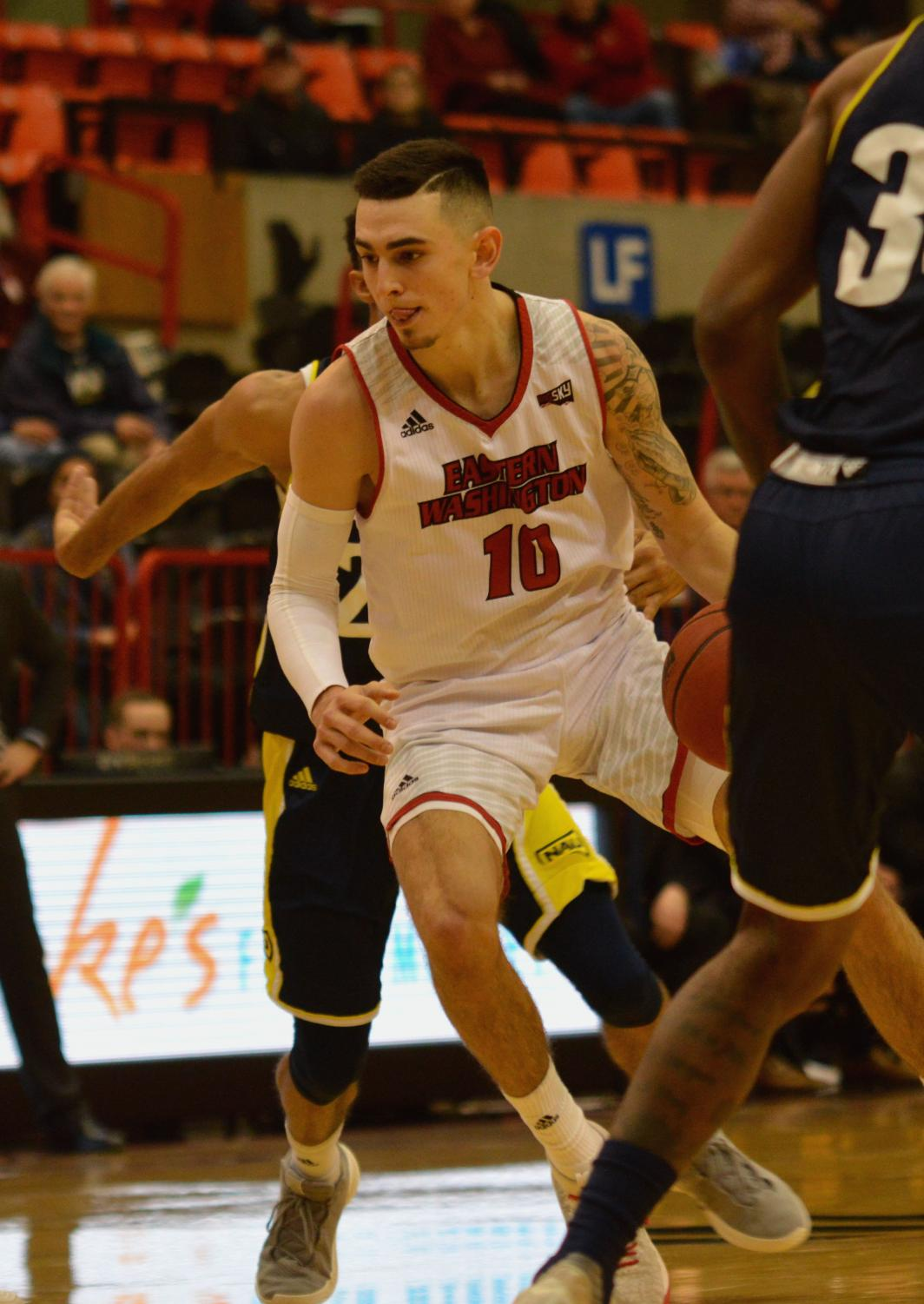 Sophomore guard Jacob Davison drives against Northern Arizona on Feb. 4. Davison scored a career-high 41 points with seven 3-pointers.
