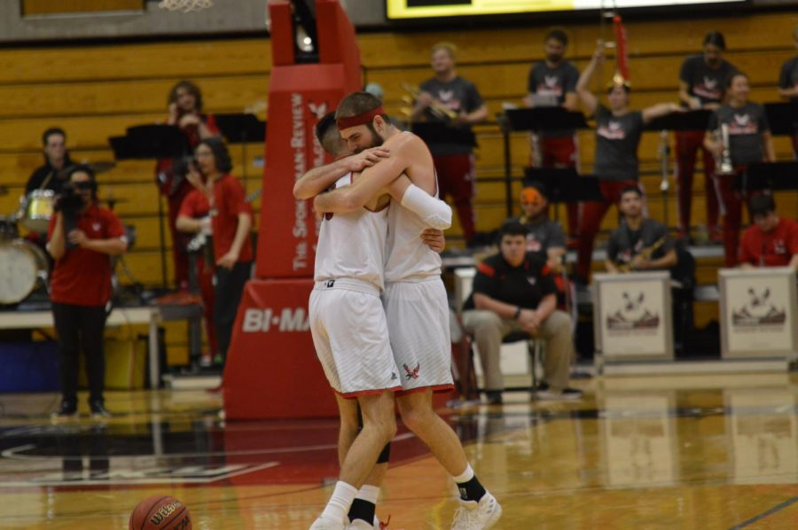 Sophomore Jacob Davison embraces senior Jesse Hunt as time expired in EWUs 82-64 win over Northern Arizona Monday night. Davison scored 14 of the Eagles first 16 points in the game.