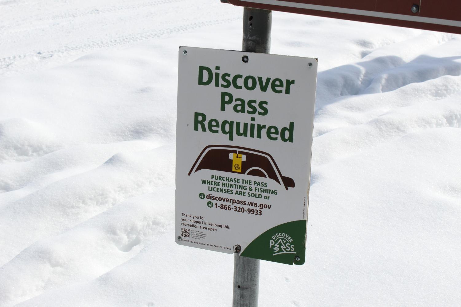 Discover Pass sign at Fish Lake in the parking lot of the Columbia Plateau State Park trailhead. Discover Passes will soon be available to be reserved from Spokane County public libraries, along with other recreational equipment.