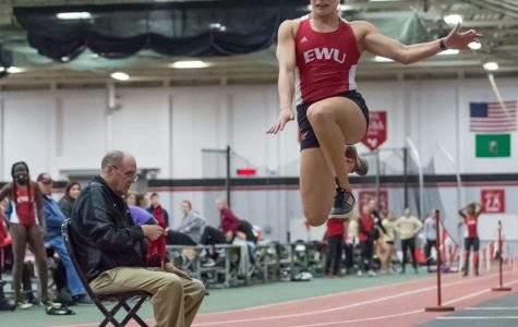 Senior Dominique Butler competes in the triple jump during the Candy Cane XI Invitational at the EWU Fieldhouse on Nov. 30. Butler set two records at the Big Sky indoor championships last weekend in the pentathlon and triple jump. Her 39-foot-7-inch effort in the triple jump earned her third place in the competition.