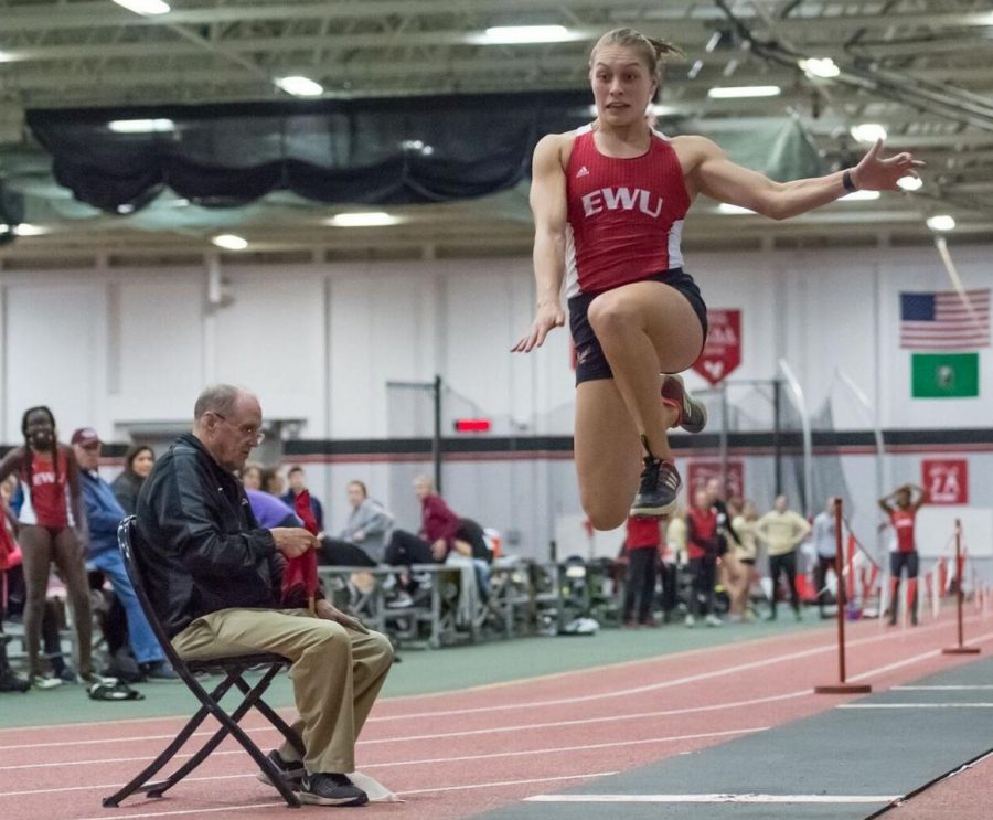 Senior+Dominique+Butler+competes+in+the+triple+jump+during+the+Candy+Cane+XI+Invitational+at+the+EWU+Fieldhouse+on+Nov.+30.+Butler+set+two+records+at+the+Big+Sky+indoor+championships+last+weekend+in+the+pentathlon+and+triple+jump.+Her+39-foot-7-inch+effort+in+the+triple+jump+earned+her+third+place+in+the+competition.
