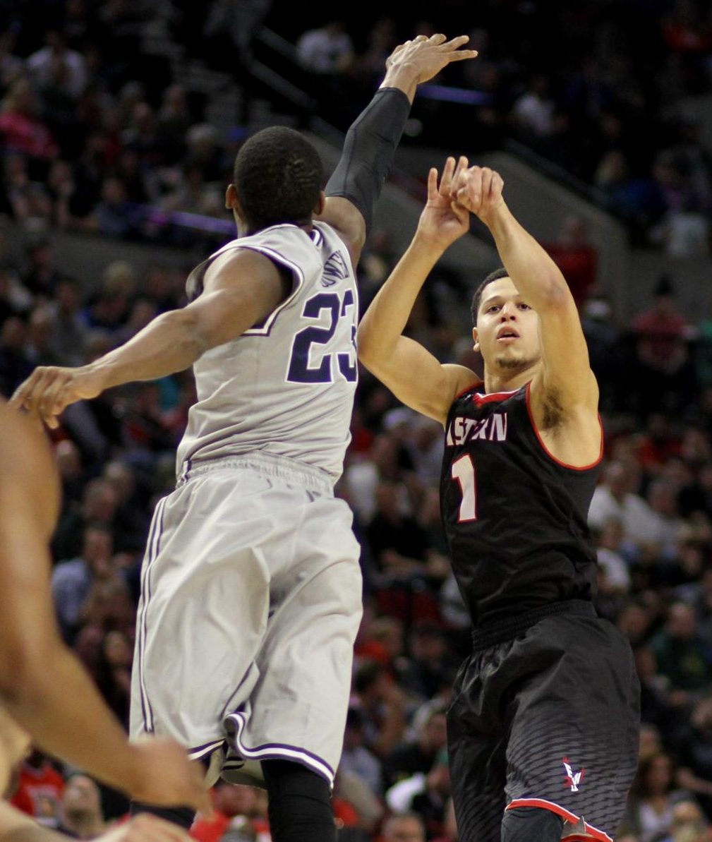 Former EWU guard Tyler Harvey shoots over a Georgetown University defender in the first round of the 2015 NCAA Tournament. In EWU's second-ever appearance in the NCAA Tournament they lost 84-74 to the No. 4 seed Hoyas.