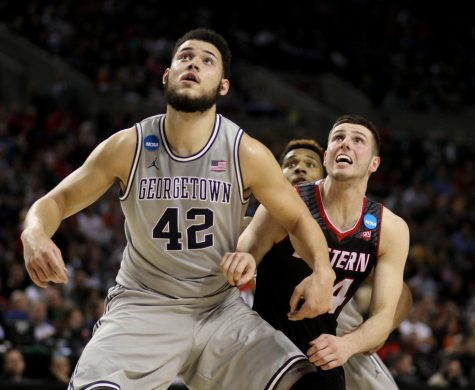 Former EWU forward Felix Von Hofe is boxed out by Georgetown University