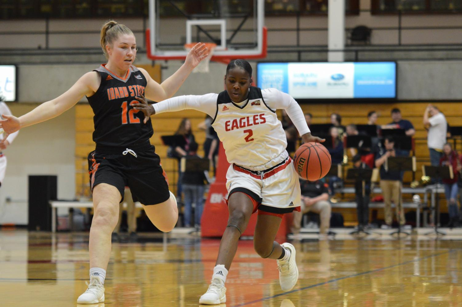 Junior forward Uriah Howard pushes off on an Idaho State defender in EWU's 74-45 loss on Thursday. The loss guaranteed the Eagles the No. 6 seed in the upcoming Big Sky Conference Tournament.