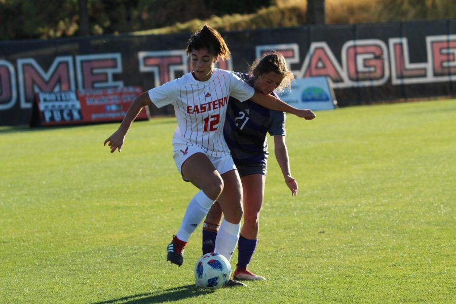 Then-junior forward Saige Lyons shakes off a Weber State defender on Oct. 12, 2018. Lyons scored three goals on 30 shots last year.
