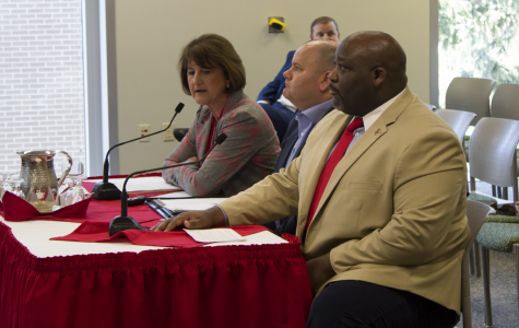 Athletic director Lynn Hickey and senior associate athletics director for external affairs Devon Thomas sit in front of the board of trustees on Friday. The BOT approved Hickey's decision to postpone the Roos Field renovation proposal until another meeting in October. This meeting occurred in 2019.