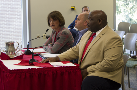 Athletic director Lynn Hickey and senior associate athletics director for external affairs Devon Thomas sit in front of the board of trustees on Friday. The BOT approved Hickey