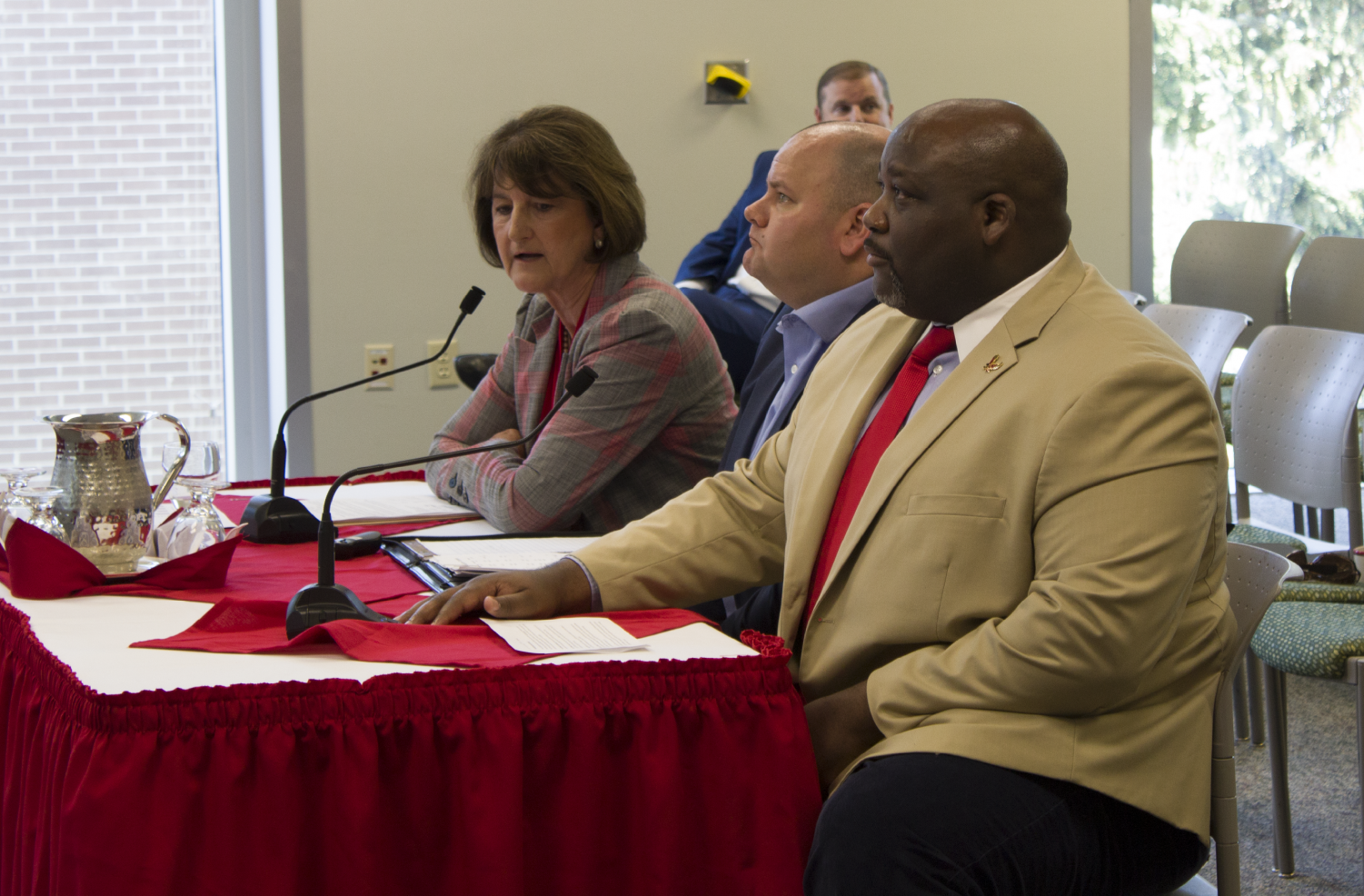 Athletic director Lynn Hickey and senior associate athletics director for external affairs Devon Thomas sit in front of the board of trustees on Friday. The BOT approved Hickey's decision to postpone the Roos Field renovation proposal until another meeting in October.