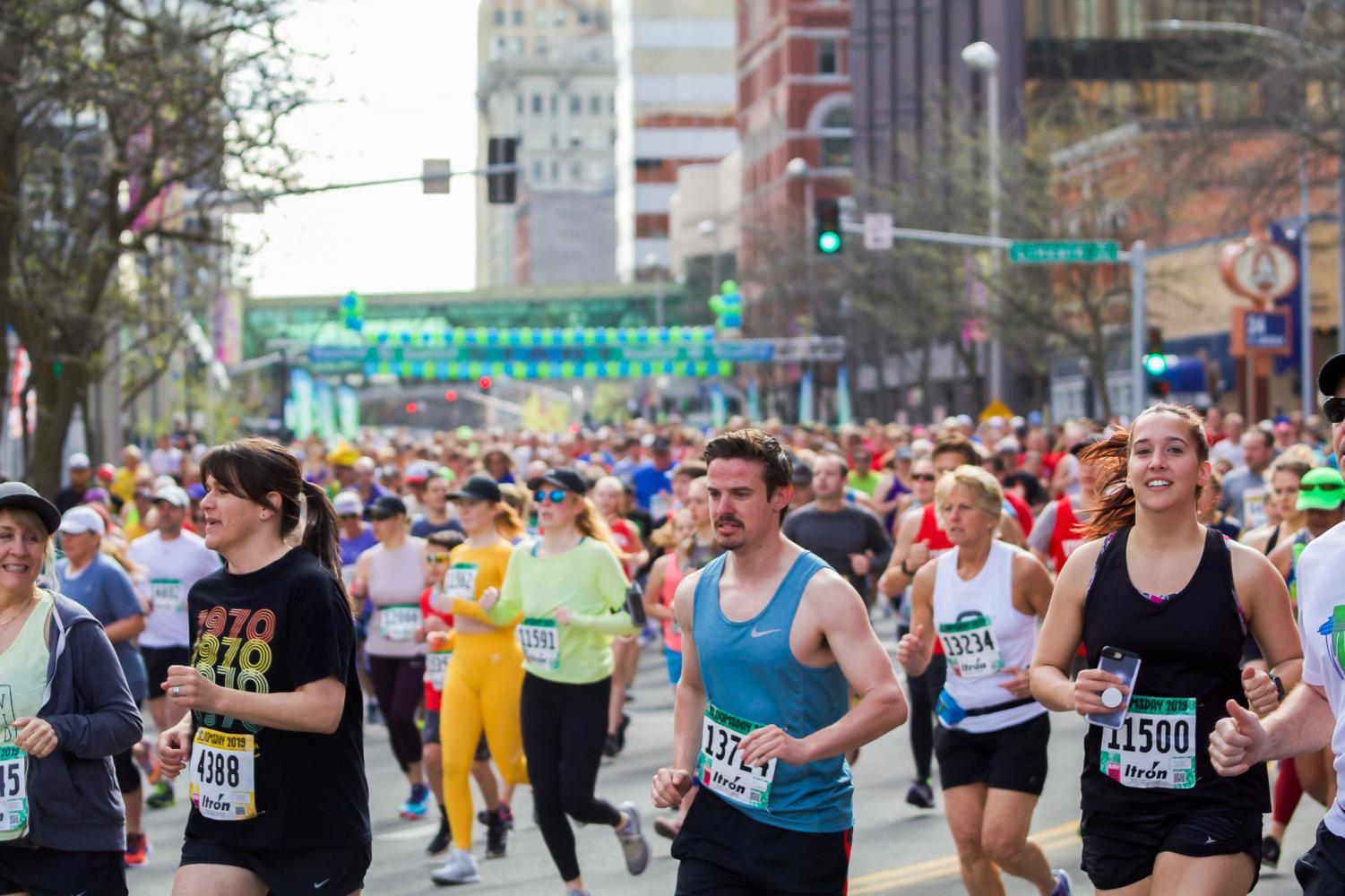 Thousands make their way through downtown Spokane on Sunday as a part of the 43rd annual Bloomsday.