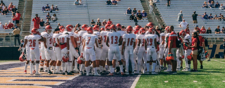 The EWU football team huddles before its season opener against Washington. EWU lost 47-14.