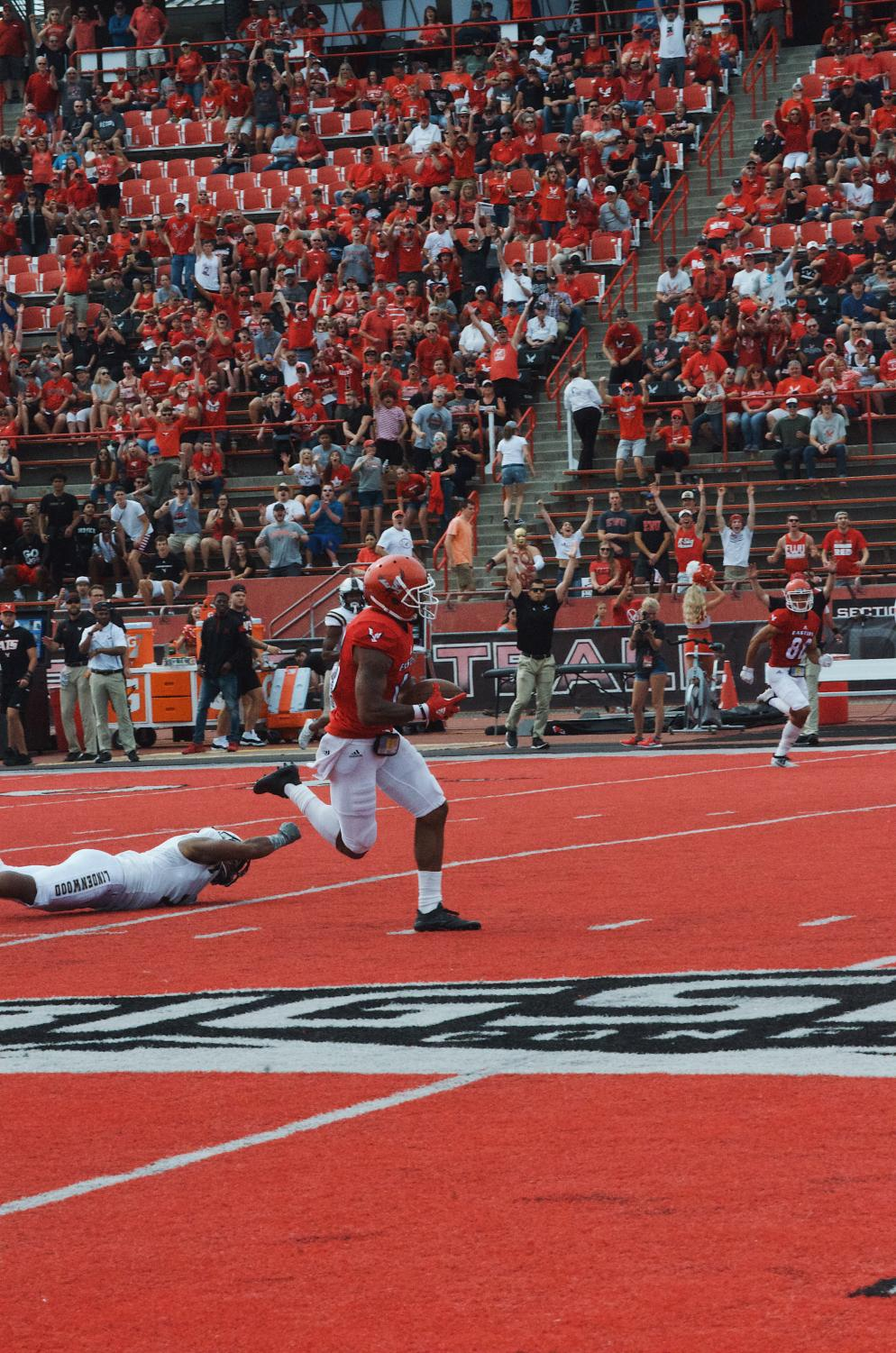 Senior wide receiver Dre Dorton breaks away for a 78-yard touchdown on EWU's first play from scrimmage Saturday. Dorton broke Cooper Kupp's school record for receiving yards in a game with 289.