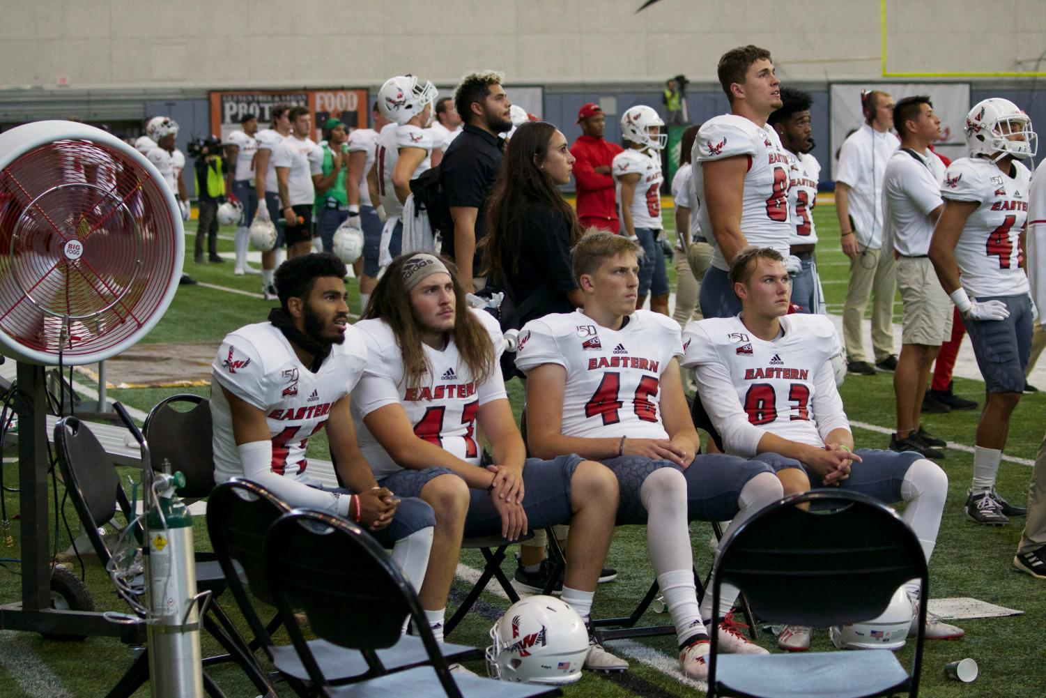 The EWU sideline looks on as Idaho marches down the field during EWU's 35-27 loss in Moscow on Sept. 21.