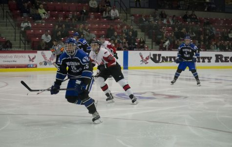 EWU and BYU players pursue the puck. BYU shut out EWU 3-0 Thursday.