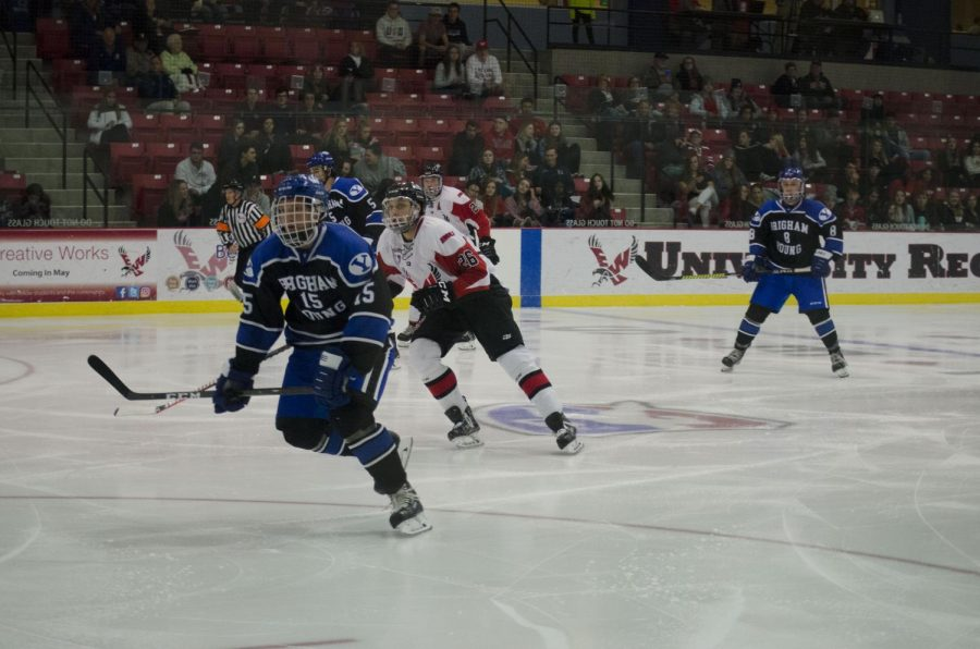 EWU+and+BYU+players+pursue+the+puck.+BYU+shut+out+EWU+3-0+Thursday.