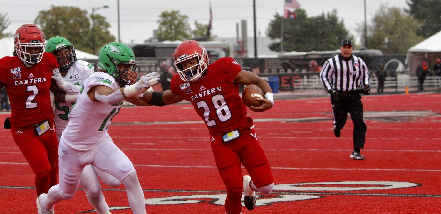 EWU senior running back Antoine Custer Jr. stiff-arms a defender during the Eagles' 35-20 victory over North Dakota on Sept. 28. Custer leads EWU in rushing this season.