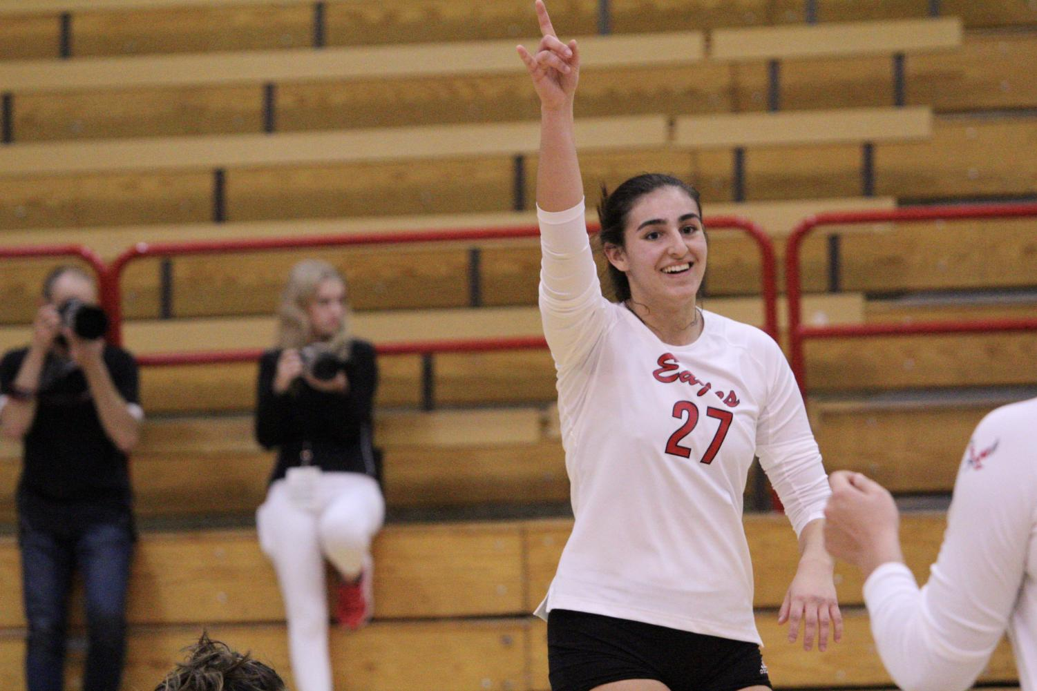Freshman Nicoletta Capizzi raises her hand triumphantly. EWU broke a 14-match losing streak by beating the Southern Utah Thunderbirds (4-3, 11-8) in a back-and-forth five set match.