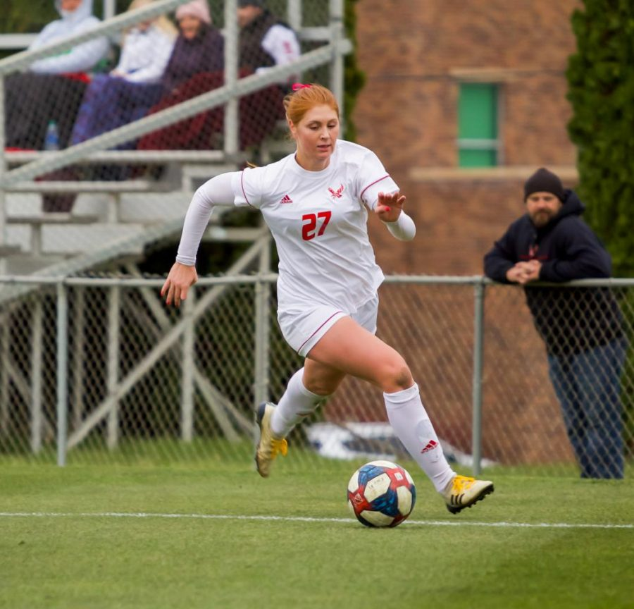 EWU senior forward Brooke Dunbar chases the ball along the sideline. Dunbar scored her fourth goal of the season during EWU's 3-0 victory over Southern Utah on Oct. 18.