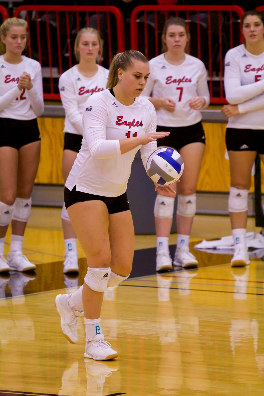 EWU junior outside hitter MaKenna Davis prepares to serve during the Eagles' 3-1 loss to Weber State Saturday.