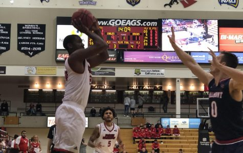EWU sophomore guard/foward Kim Aiken Jr. attempts a jump shot. Aiken had 11 points and 11 rebounds in EWU's 87-82 victory over Belmont Tuesday.