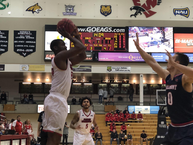 EWU sophomore guard/foward Kim Aiken Jr. attempts a jump shot. Aiken had 11 points and 11 rebounds in EWU's 87-82 victory over Belmont Tuesday.