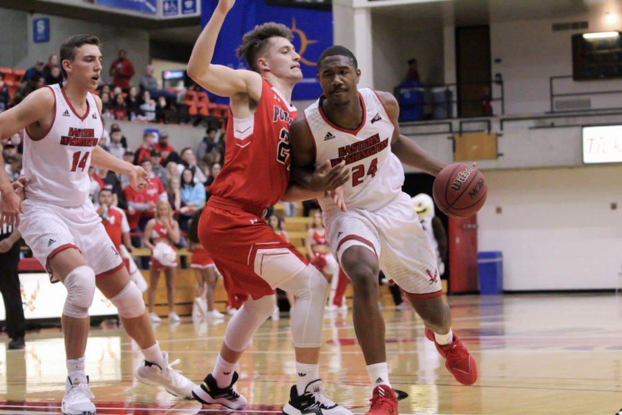 EWU sophomore guard/forward Kim Aiken Jr. drives to the rim. Aiken scored 14 points and EWU beat Portland Bible College 107-25.